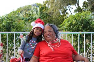 African-American girl and her grandmother, dressed in holiday clothes